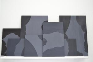 inclement series of paining displayed on shelf